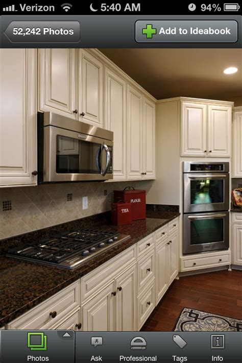 glazed cabinets out of style biscotti with cocoa glaze cabinets and dark brown granite