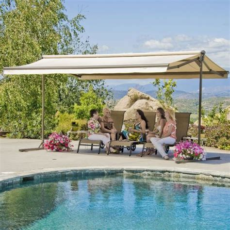 sunsetter oasis freestanding awning motorized  manually operated versions outdoor