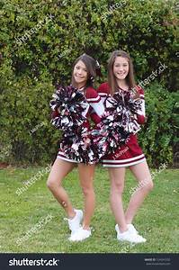 Two Very Cute Teen Aged Cheerleaders Posing Outdoors On A ...