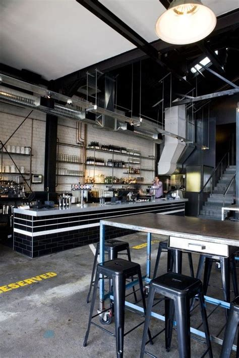kitchen restaurant industrial bar and black subway tiles on Industrial