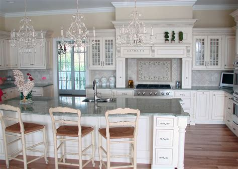 White Cabinets With Granite by Costa Esmeralda Granite
