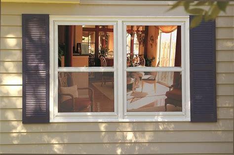 storm windows types materials advantages  disadvantages