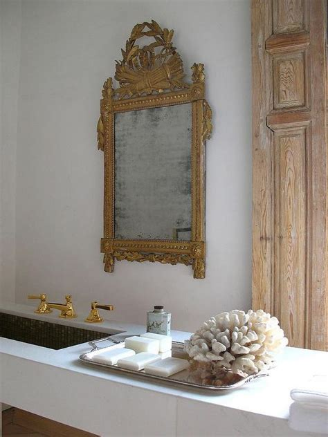 marble floating vanity  gold ornate mirror french