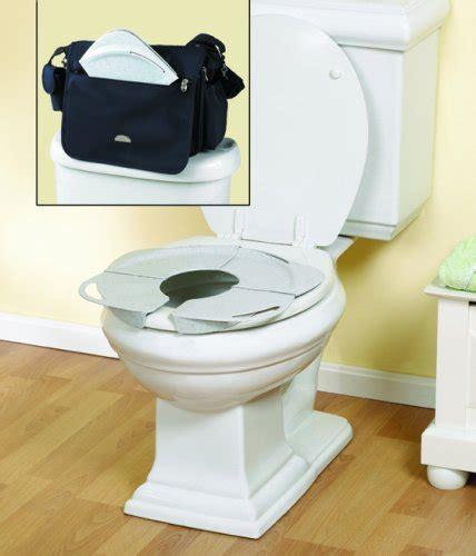 the folding potty seat primo products inc folding potty seat w handles by oj