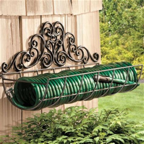 coiled garden hose holder  skymall   outdoor