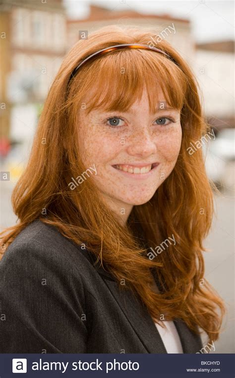 Portrait Of A Teenage Girl With Red Hair Blue Eyes And