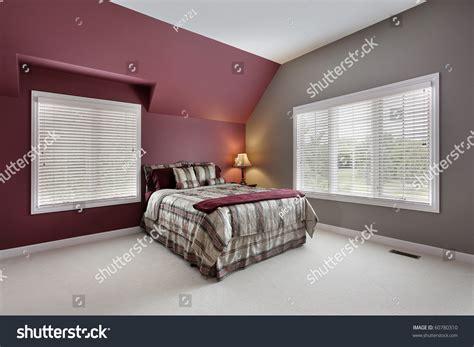 large bedroom maroon gray walls stock photo