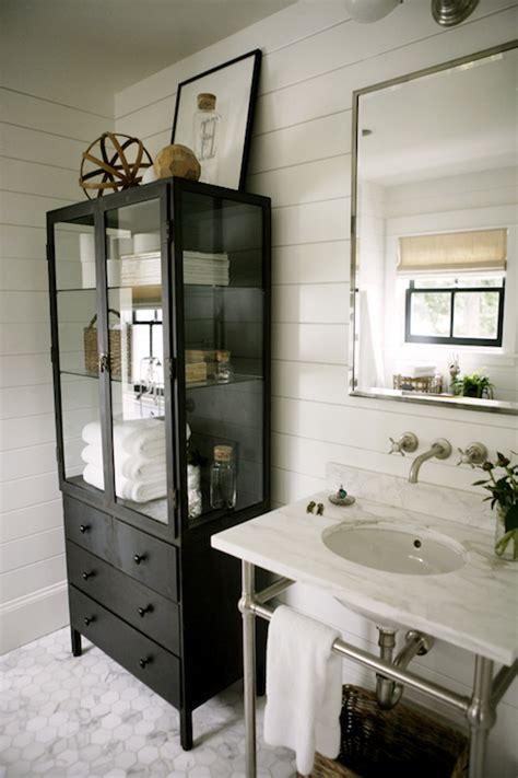 glass front bathroom linen cabinet  polished brass