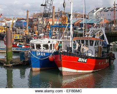 Old Boat At Portsmouth by Fishing Trawler At Camber Quay Old Portsmouth Stock Photo