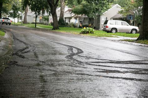 letter carrier drives freshly laid road surface prairie village