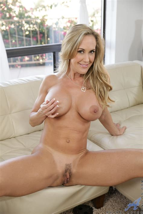 Brandi Love in sexy shoes posing on sofa - My Pornstar Book