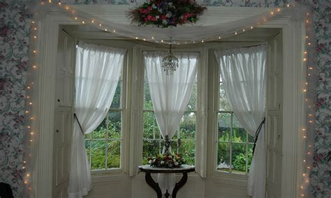 Old fashioned bedroom furniture, small bay window curtain