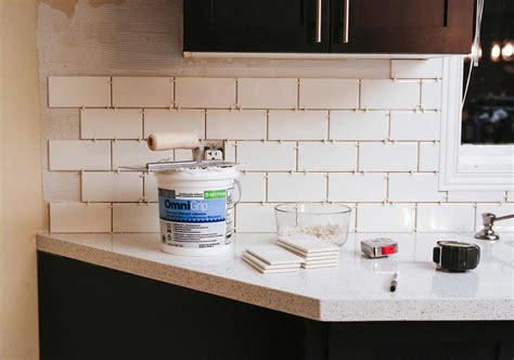 installed  subway tile backsplash brittany stager