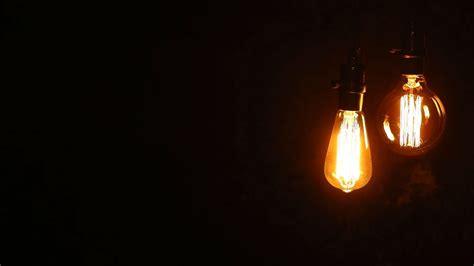 incandescent light bulbs retro hanging light bulbs on black background loop