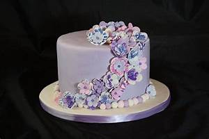 Single tier 'birthday cake' covered with purple fondant ...