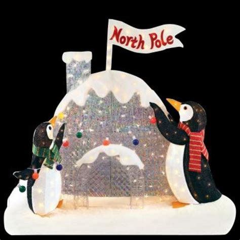 light up penguin christmas decoration home accents 4 ft h pre lit tinsel and acrylic penguins with igloo ty469 1311 the