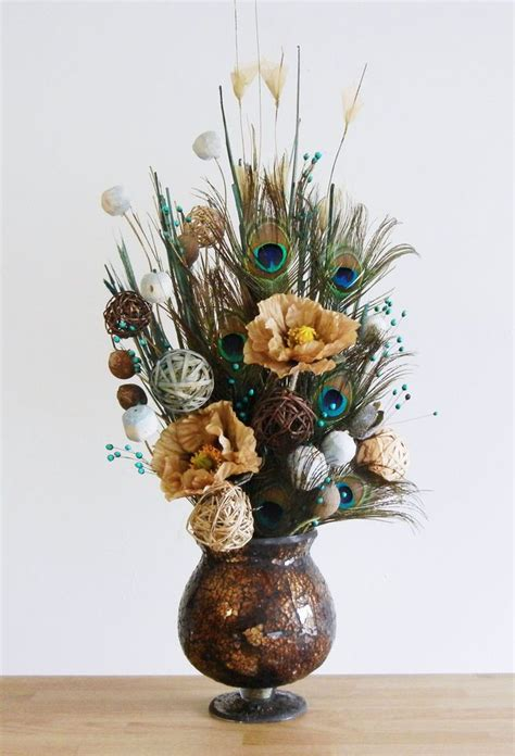 earthy peacock feather floral arrangement  brown