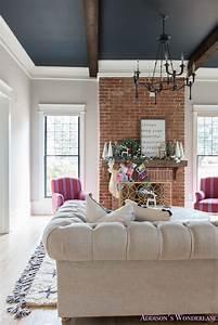 vintage-living-room-black-ceiling-brick-fireplace-dark