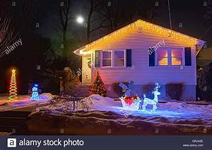 Nighttime and christmas lights on a house are lit up