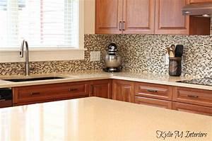cream quartz countertops, cherry kitchen cabinets, small