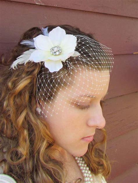 bridal hair clip in ivory with birdcage veil beauty
