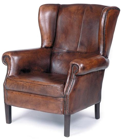 traditional wing back leather chair w nailhead trim wood legs