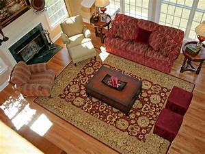 Living room rugs in plain and patterned designs traba homes for Rug under sectional sofa