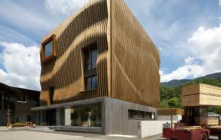 Basement Parking Section by Stunning Wood Facade Appears As Rippling Waves On An