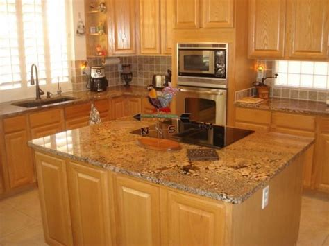 what color countertops go with oak cabinets this color granite works with oak cabinets and light
