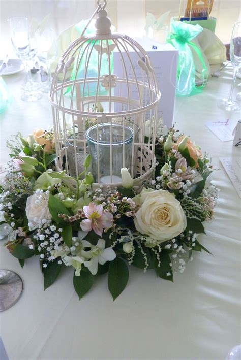 cheap vintage wedding decorations uk birdcage centrepiece filled with candles glassware and