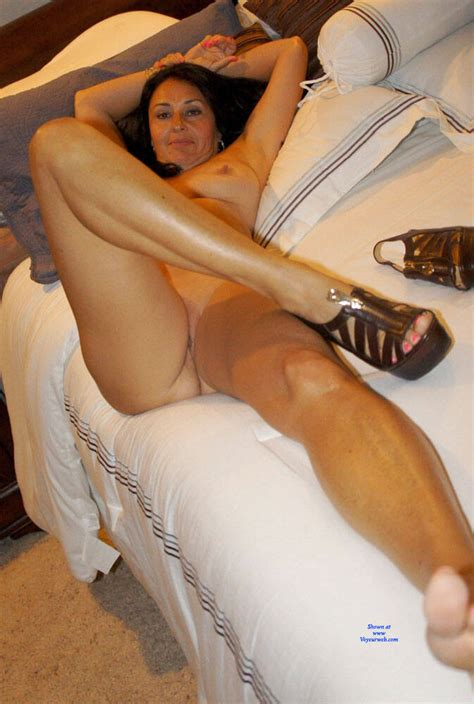 Amazing Brunette Milf Posing On Bed Preview February
