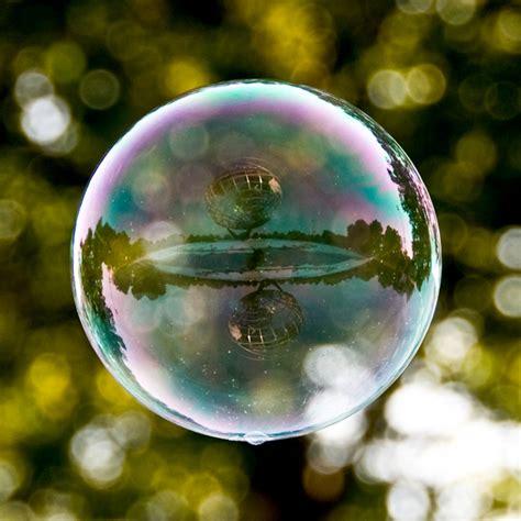 world landmarks reflected  bubbles