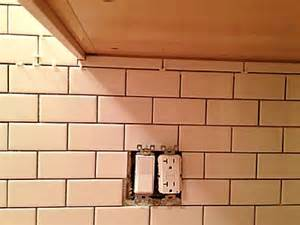 installing ceramic wall tile kitchen backsplash install ceramic subway wall tiles as a kitchen backsplash