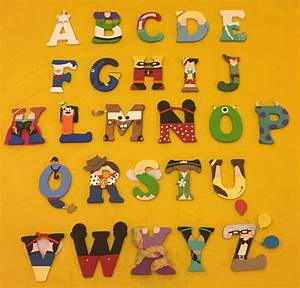 the alphabet made up of different disney characters great With letters made from photos