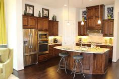kitchen with island knotty alder walnut with black glaze cabinetry shiloh 7172