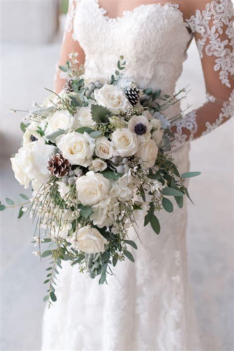 wintery white rose pine cone  silver brunia bouquet
