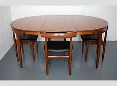 Dining table and chairs by Hans Olsen for Frem Rojle