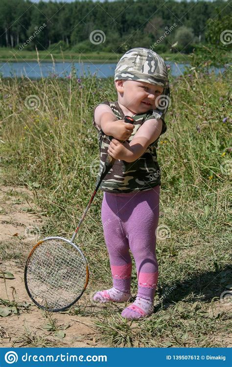 Raketsonyeondan) is a 2021 south korean sports drama television series. Little Boy With Badminton Racket Standing On The Field. Stock Photo - Image of cute, person ...