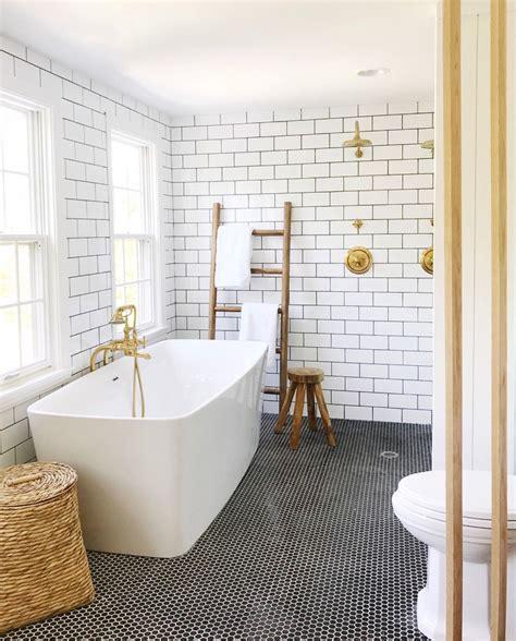 white subway tile   black penny floors   Bathrooms