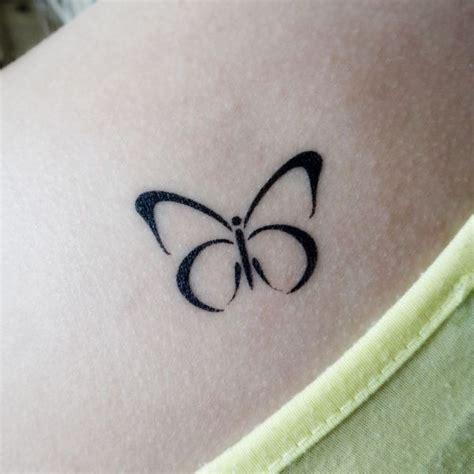 tatouage papillon simple cochese tattoo