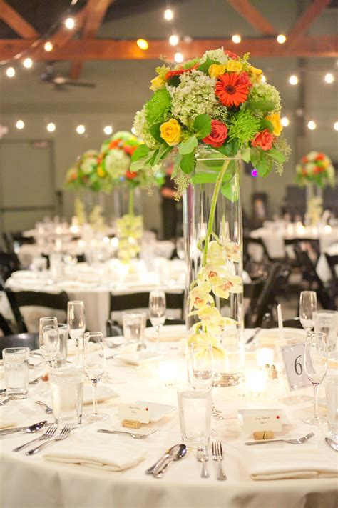Bright Wedding Centerpiece Designed In A Tall Glass