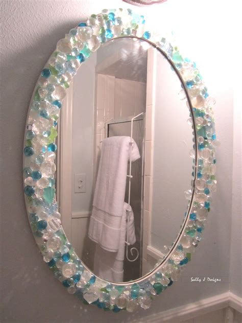 Mirror in small bathroom is a DIY with sea glass, crystals