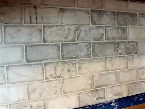 how to install a backsplash in kitchen how to install a marble tile backsplash hgtv