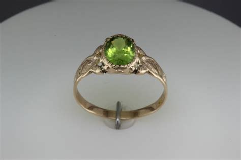 The Vivid, Bright, And Lively Peridot Remember When Antiques Modesto And Uniques Ohio Antique Chairs Cane Seats Mall Dallas Texas White Dresser With Mirror Buffet Table Houston Tx Dublin Auctioneers