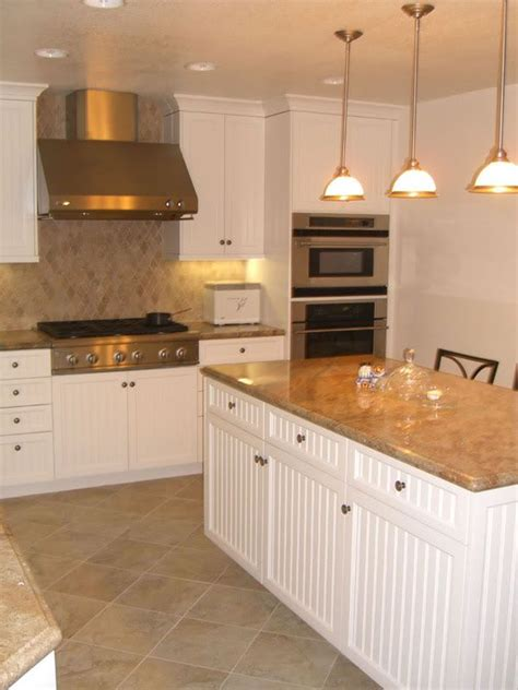 how to add color to a kitchen white kitchen cabinets travertine tile floors for the 9279