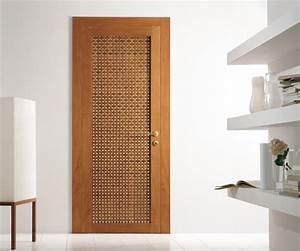 Modern interior swing door featuring a cherry wood lattice ...
