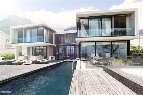 Modern House With Large Patio And Swimming Pool Stock