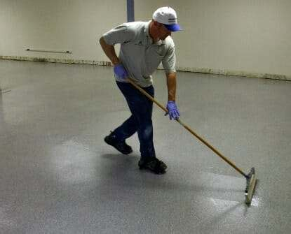 garage floor paint how to apply 10 reasons to add a clear top coat to an epoxy garage floor all garage floors