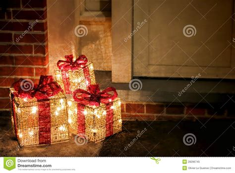 lighted decorated christmas gifts boxes  doorway stock