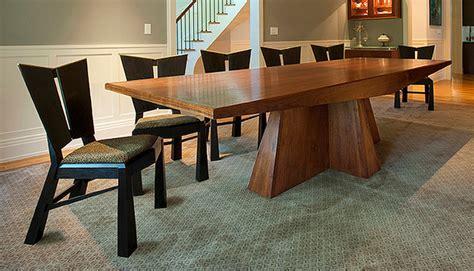 modern walnut dining table and ebonized charis modern